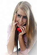 Blonde girl with glasses and red phone